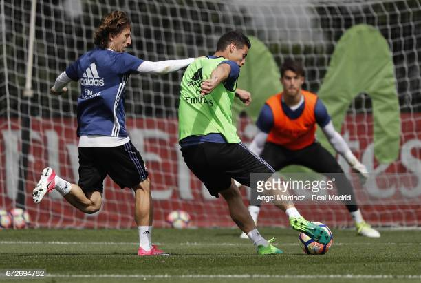 Luka Modric and James Rodriguez of Real Madrid in action during a training session at Valdebebas training ground on April 25 2017 in Madrid Spain