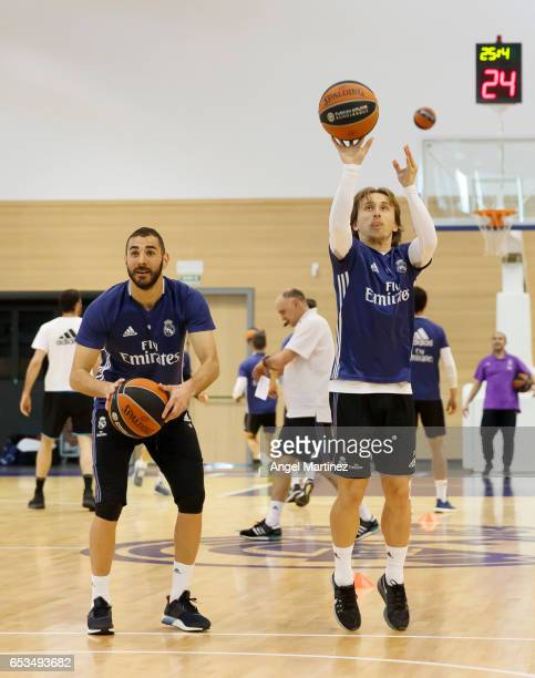 Luka Modric and Karim Benzema of Real Madrid in action during a training session at Ciudad Real Madrid basketball court on March 14 2017 in Madrid...