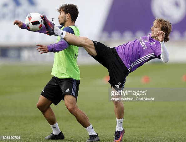 Luka Modric and Lucas Silva of Real Madrid in action during a training session at Valdebebas training ground on November 29 2016 in Madrid Spain