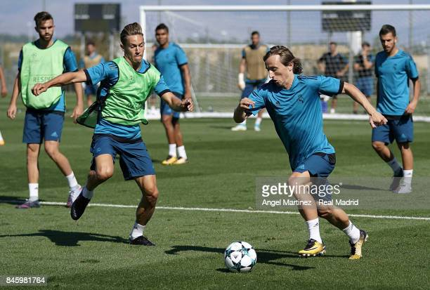 Luka Modric and Marcos Llorente of Real Madrid in action during a training session at Valdebebas training ground on September 12 2017 in Madrid Spain
