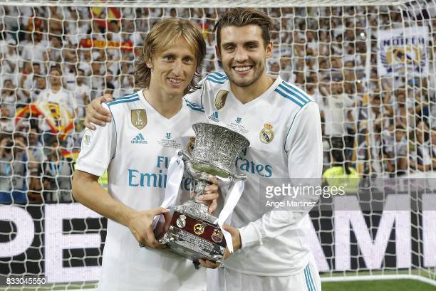 Luka Modric and Mateo Kovacic of Real Madrid celebrate with the trophy after the Supercopa de Espana Final second leg match between Real Madrid and...