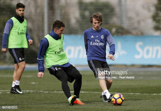 Luka Modric and Mateo Kovacic of Real Madrid in action during a training session at Valdebebas training ground on March 3 2017 in Madrid Spain