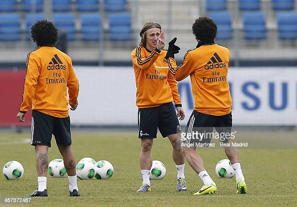 Luka Modric and Pepe of Real Madrid joke during a training session at Ciudad Real Madrid on December 17 2013 in Madrid Spain