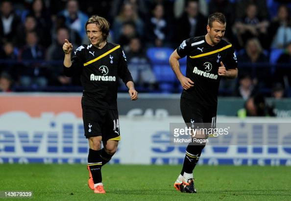 Luka Modric celebrates scoring the opening goal with team mate Rafael van der Vaart of Tottenham Hotspur during the Barclays Premier League match...