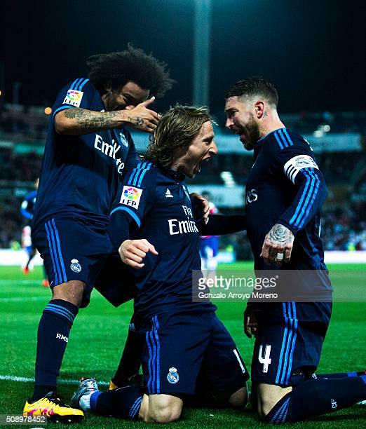 Luka Modric celebrates scoring their second goal with teammates Sergio Ramos and Marcelo during the La Liga match between Granada CF and Real Madrid...