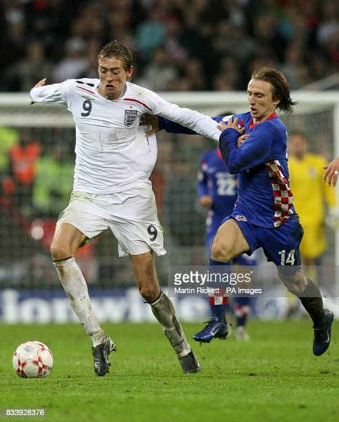 Luka Modric Croatia and Peter Crouch England battle for the ball