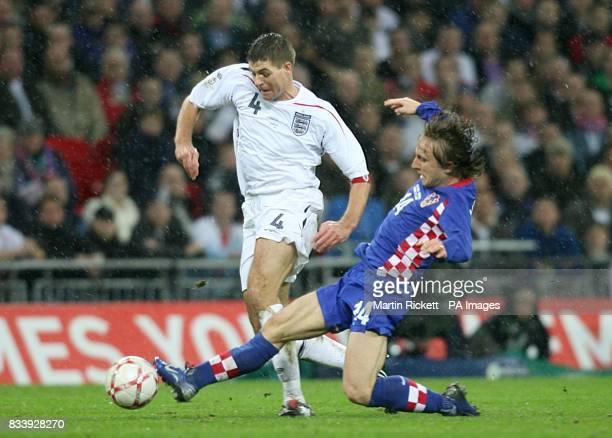 Luka Modric Croatia and Steven Gerrard England battle for the ball