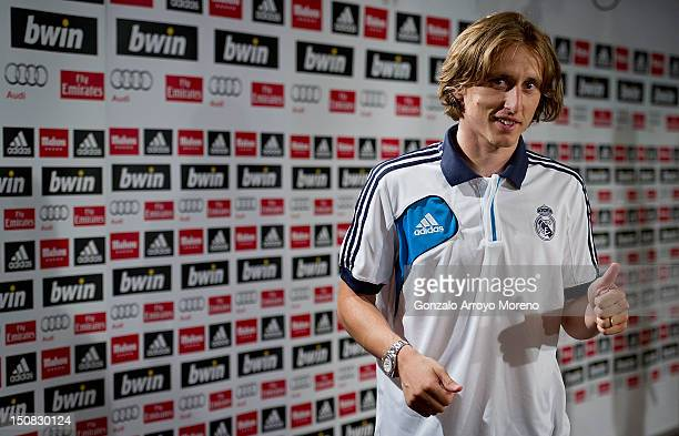 Luka Modric gives the thumbs up during a press conference to present him as a new Real Madrid player at Estadio Santiago Bernabeu on August 27 2012...