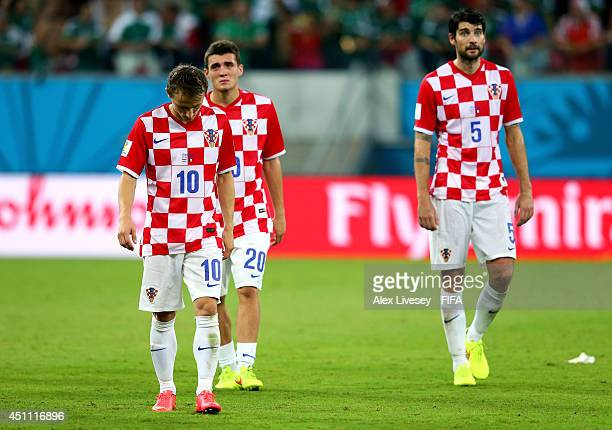 Luka Modric Mateo Kovacic and Vedran Corluka of Croatia walk off the pitch after the 13 defeat in the 2014 FIFA World Cup Brazil Group A match...