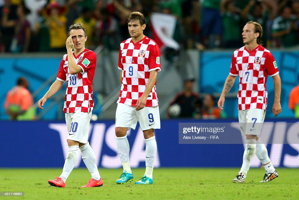 <a gi-track='captionPersonalityLinkClicked' href=/galleries/search?phrase=Luka+Modric&family=editorial&specificpeople=560350 ng-click='$event.stopPropagation()'>Luka Modric</a>, <a gi-track='captionPersonalityLinkClicked' href=/galleries/search?phrase=Nikica+Jelavic&family=editorial&specificpeople=5986831 ng-click='$event.stopPropagation()'>Nikica Jelavic</a> and <a gi-track='captionPersonalityLinkClicked' href=/galleries/search?phrase=Ivan+Rakitic&family=editorial&specificpeople=3987920 ng-click='$event.stopPropagation()'>Ivan Rakitic</a> of Croatia show their dejection after conceding the third goal to Mexico during the 2014 FIFA World Cup Brazil Group A match between Croatia and Mexico at Arena Pernambuco on June 23, 2014 in Recife, Brazil.