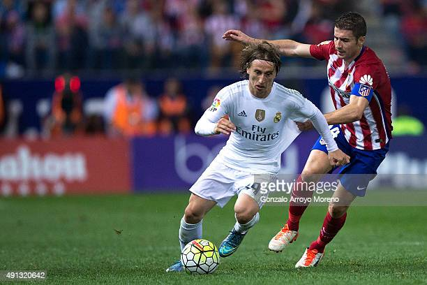 Luka Modric of Atletico de Madrid competes for the ball with Gabi Fernandez of Atletico de Madrid during the La Liga match between Club Atletico de...