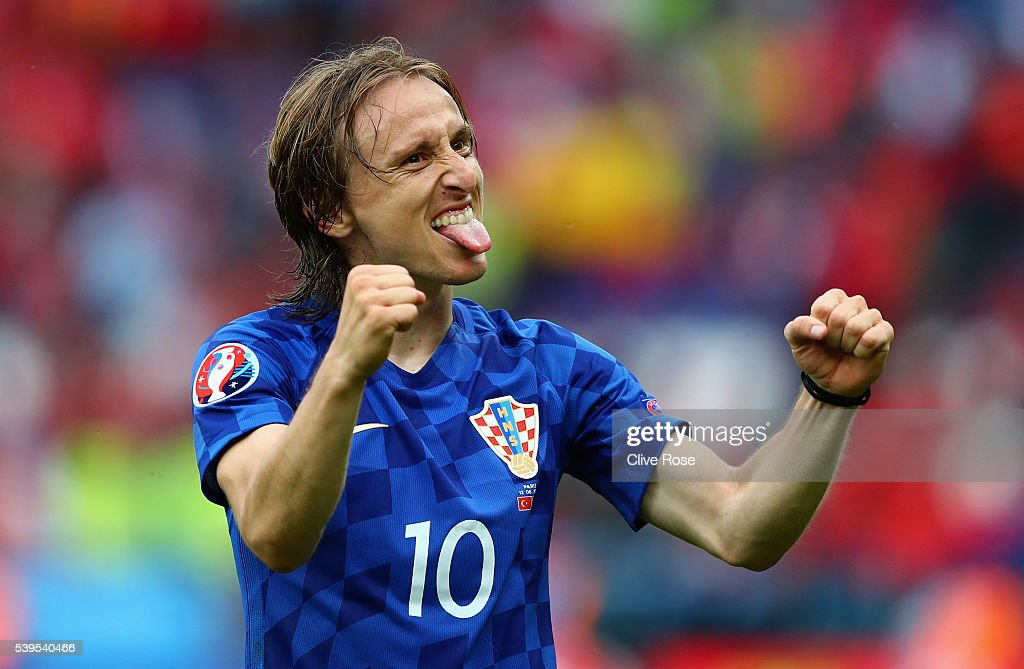 <a gi-track='captionPersonalityLinkClicked' href=/galleries/search?phrase=Luka+Modric&family=editorial&specificpeople=560350 ng-click='$event.stopPropagation()'>Luka Modric</a> of Croatia celebrates his team's 1-0 win in the UEFA EURO 2016 Group D match between Turkey and Croatia at Parc des Princes on June 12, 2016 in Paris, France.