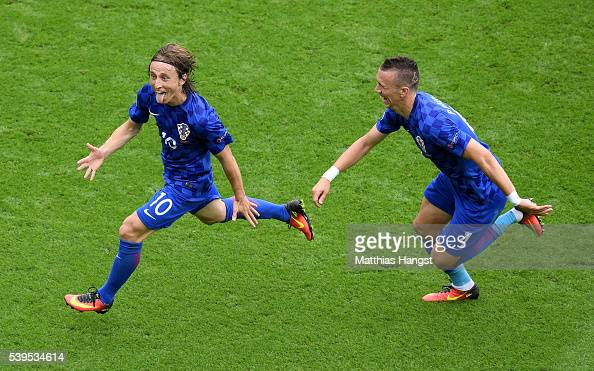 Luka Modric of Croatia celebrates scoring his team's first goal with his team mate Ivan Perisic during the UEFA EURO 2016 Group D match between...