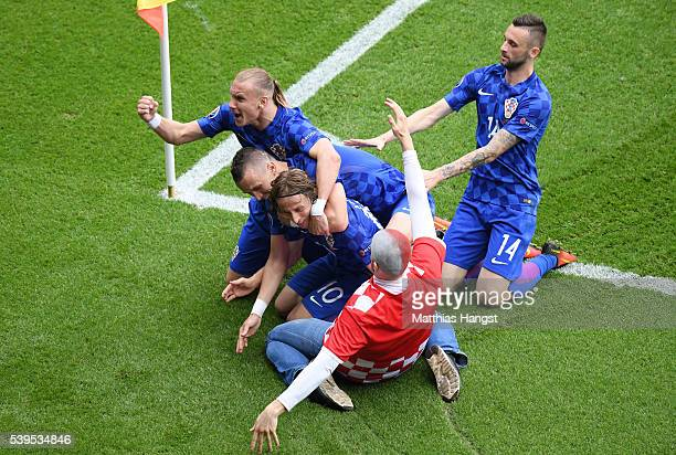 Luka Modric of Croatia celebrates scoring his team's first goal with his team mates and a fan during the UEFA EURO 2016 Group D match between Turkey...