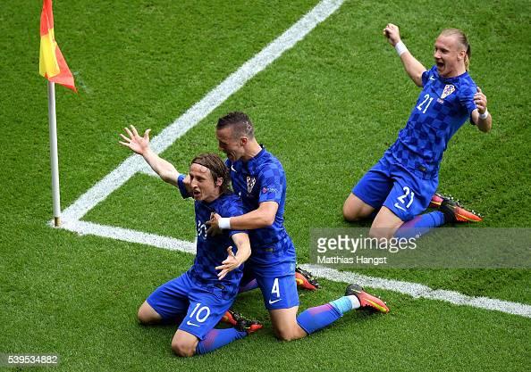 Luka Modric of Croatia celebrates scoring his team's first goal with his team mates Ivan Perisic and Domagoj Vida during the UEFA EURO 2016 Group D...