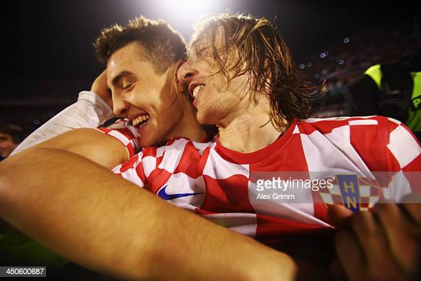 Luka Modric of Croatia celebrates with team mate Mateo Kovacic after the FIFA 2014 World Cup Qualifier playoff second leg match between Croatia and...