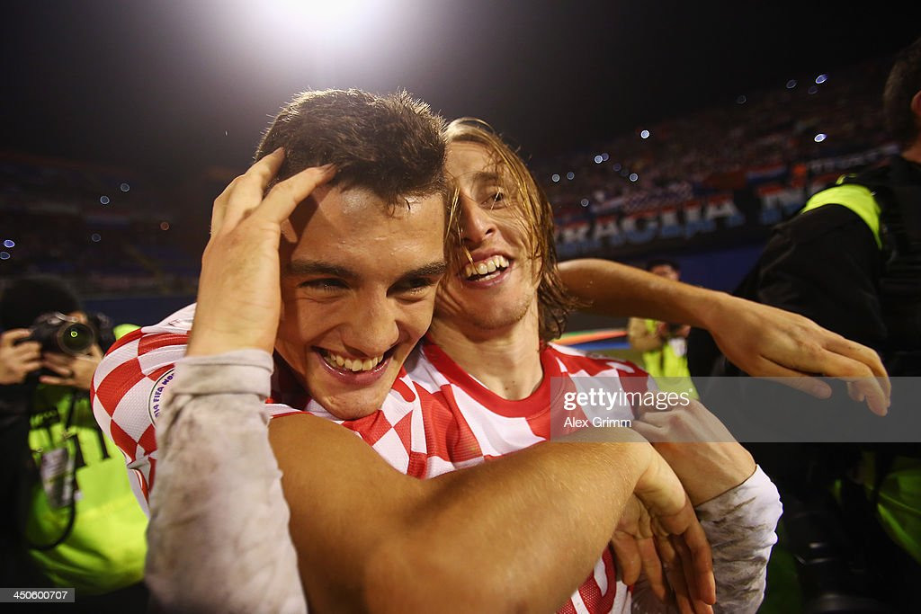 Luka Modric (R) of Croatia celebrates with team mate Mateo Kovacic after the FIFA 2014 World Cup Qualifier play-off second leg match between Croatia and Iceland at Maksimir Stadium on November 19, 2013 in Zagreb, Croatia.