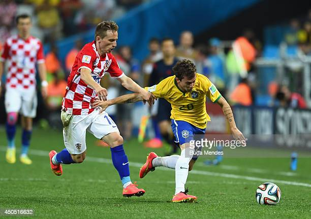 Luka Modric of Croatia closes down Bernard of Brazil during the 2014 FIFA World Cup Brazil Group A match between Brazil and Croatia at Arena de Sao...