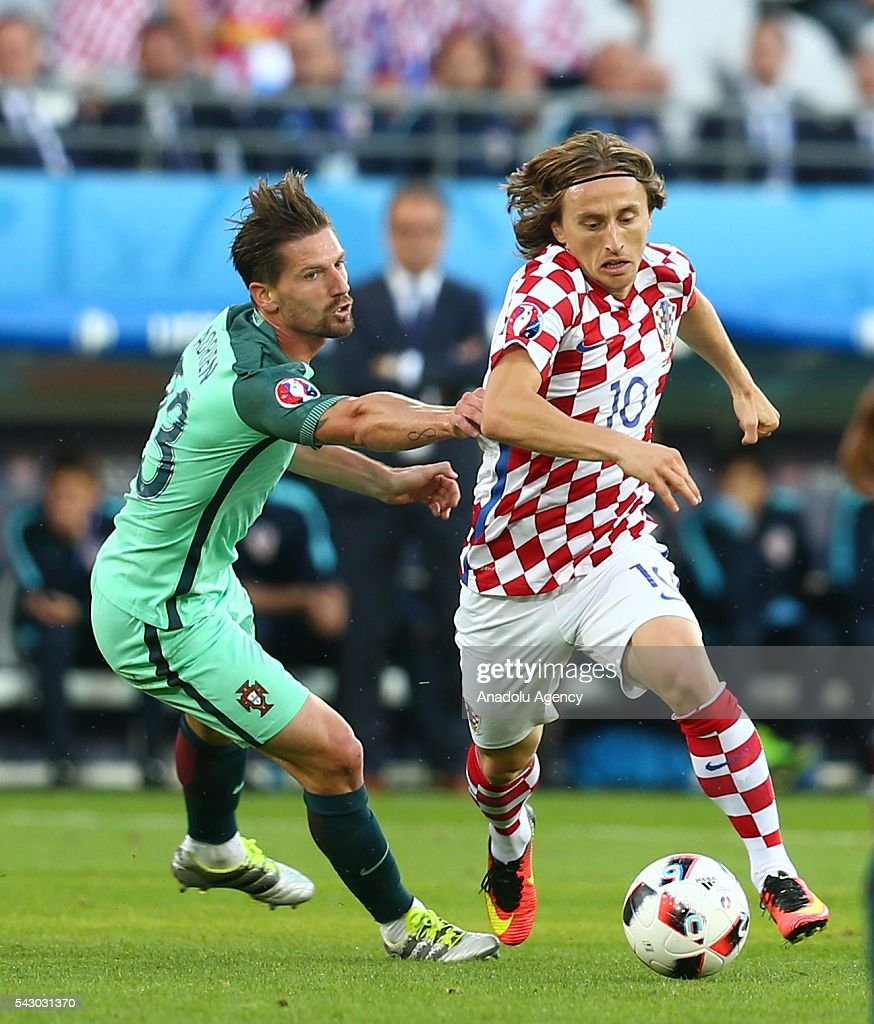 Luka Modric (R) of Croatia in action against Adrien Silva (L) of Portugal during the Euro 2016 round of 16 football match between Croatia and Portugal at Stade Bollaert-Delelis in Lens, France on June 25, 2016.