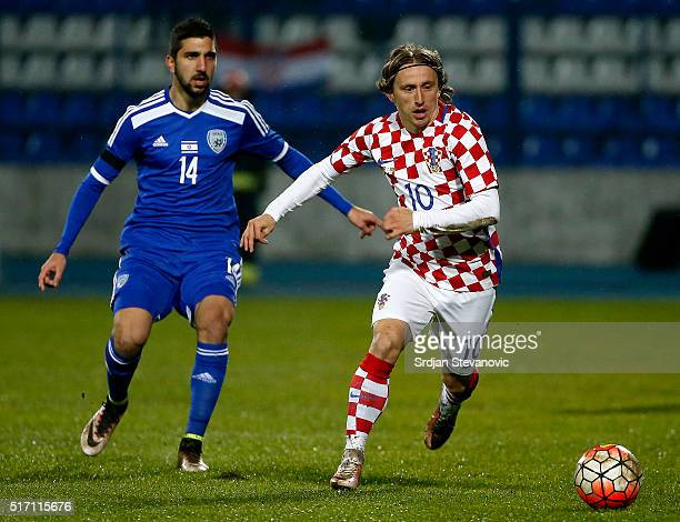 Luka Modric of Croatia in action against Muanes Dabbur of Israel during the International Friendly match between Croatia and Israel at stadium...