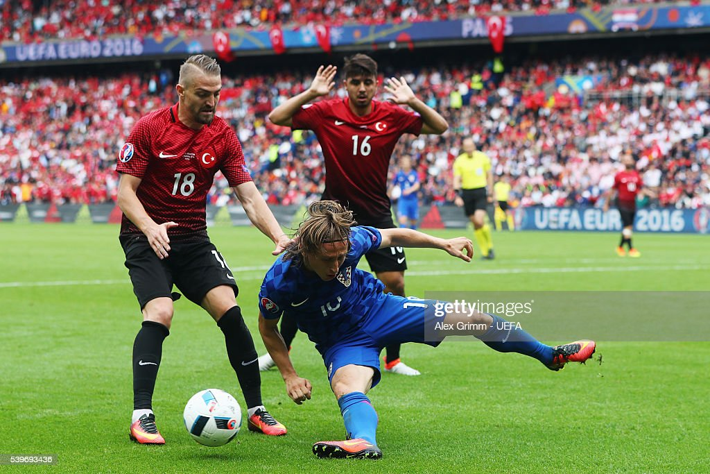 <a gi-track='captionPersonalityLinkClicked' href=/galleries/search?phrase=Luka+Modric&family=editorial&specificpeople=560350 ng-click='$event.stopPropagation()'>Luka Modric</a> of Croatia is challenged by <a gi-track='captionPersonalityLinkClicked' href=/galleries/search?phrase=Caner+Erkin&family=editorial&specificpeople=5127933 ng-click='$event.stopPropagation()'>Caner Erkin</a> of Turkey during the UEFA EURO 2016 Group D match between Turkey and Croatia at Parc des Princes on June 12, 2016 in Paris, France.