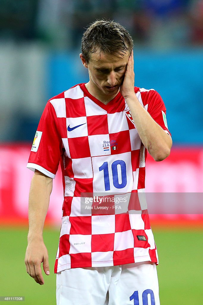 <a gi-track='captionPersonalityLinkClicked' href=/galleries/search?phrase=Luka+Modric&family=editorial&specificpeople=560350 ng-click='$event.stopPropagation()'>Luka Modric</a> of Croatia reacts after the 1-3 defeat in the 2014 FIFA World Cup Brazil Group A match between Croatia and Mexico at Arena Pernambuco on June 23, 2014 in Recife, Brazil.