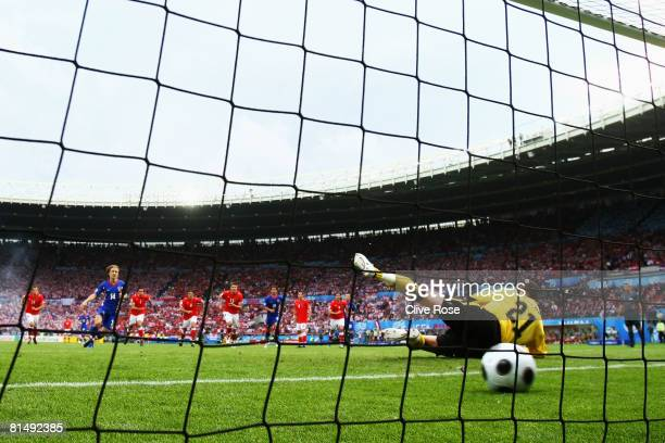 Luka Modric of Croatia scores the opening goal off the penalty spot against goalkeeper Juergen Macho of Austria during the UEFA EURO 2008 Group B...