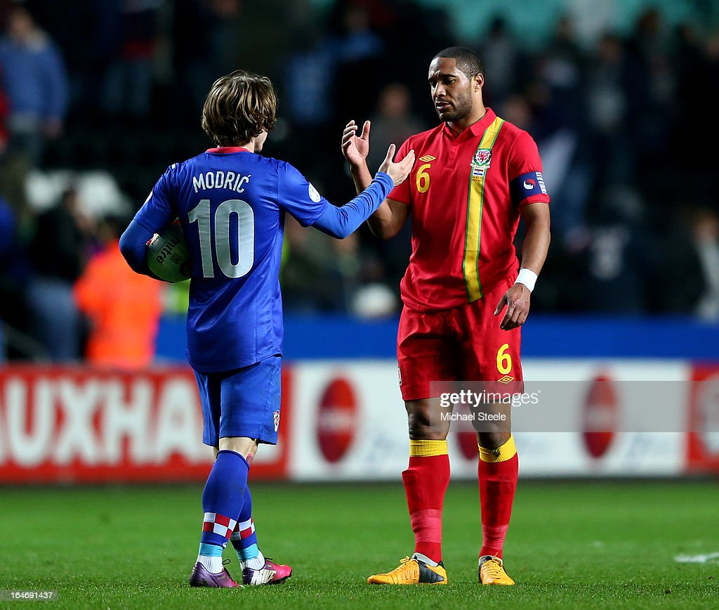 Luka Modric of Croatia shakes hands with Ashley Williams of Wales following Croatia's 2-1 victory during the FIFA 2014 World Cup qualifier between Wales and Croatia at The Liberty Stadium on March 26, 2013 in Swansea, Wales.