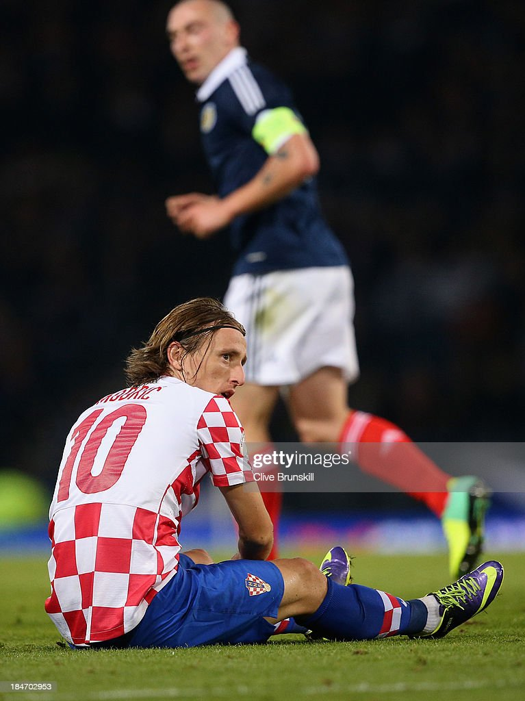 <a gi-track='captionPersonalityLinkClicked' href=/galleries/search?phrase=Luka+Modric&family=editorial&specificpeople=560350 ng-click='$event.stopPropagation()'>Luka Modric</a> of Croatia shows his dejection during the FIFA 2014 World Cup Qualifying Group A match between Scotland and Croatia at Hampden Park on October 15, 2013 in Glasgow, Scotland.