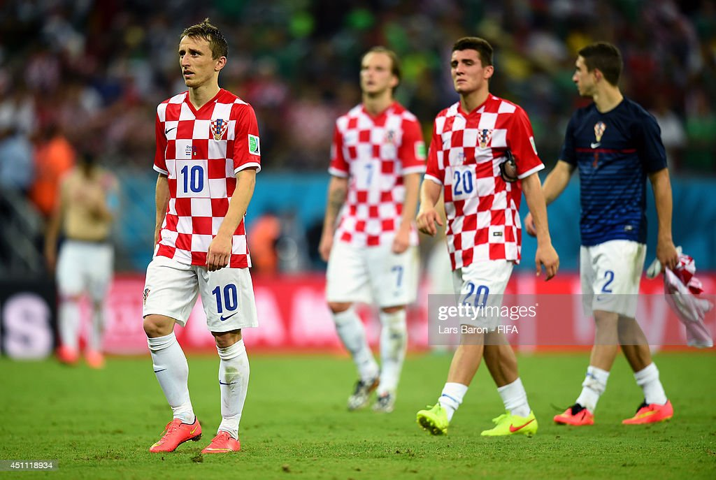 Luka Modric of Croatia (L) walks off the pitch dejected with team-mates after losing the 2014 FIFA World Cup Brazil Group A match between Croatia and Mexico at Arena Pernambuco on June 23, 2014 in Recife, Brazil.