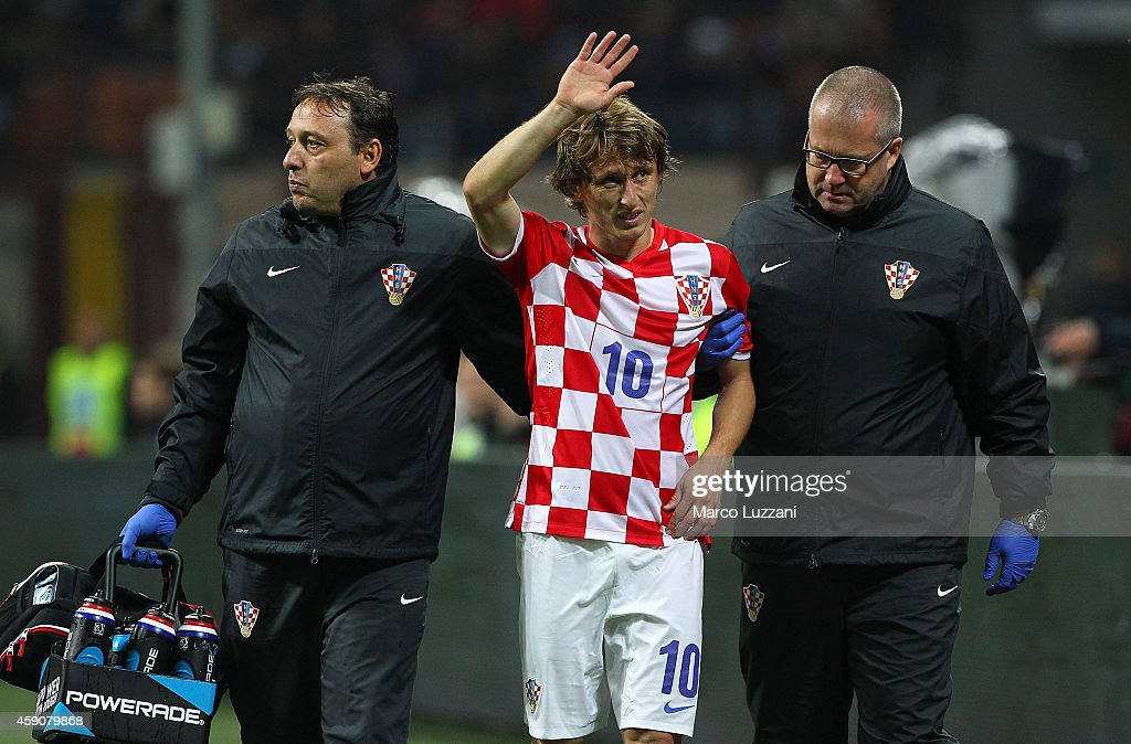 Luka Modric of Croatia walks off with an injury during the EURO 2016 Group H Qualifier match between Italy and Croatia at Stadio Giuseppe Meazza on...
