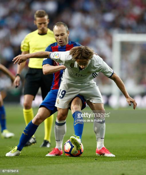 Luka Modric of Real Madrid and Andres Iniesta of Cf Barcelona compete for the ball during the La Liga match between Real Madrid CF and Barcelona at...