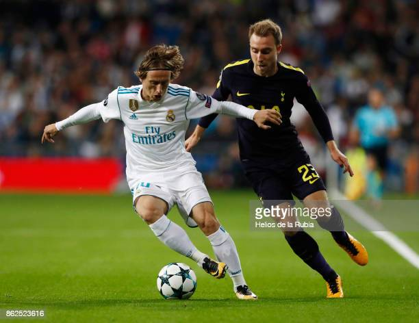 Luka Modric of Real Madrid and Christian Eriksen of Totteham Hotspur compete for the ball during the UEFA Champions League group H match between Real...