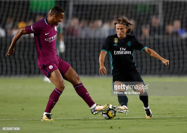 Luka Modric of Real Madrid and Danilo of MAnchester City compete for the ball during the International Champions Cup 2017 match between Manchester...