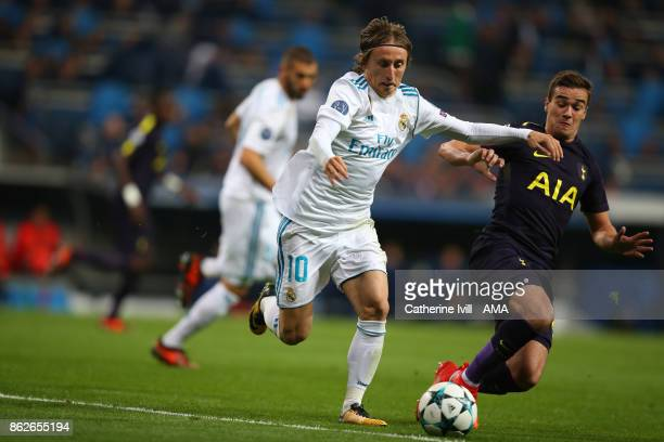 Luka Modric of Real Madrid and Harry Winks of Tottenham Hotspur during the UEFA Champions League group H match between Real Madrid and Tottenham...