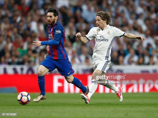 Luka Modric of Real Madrid and Lionel Messi of Cf Barcelona compete for the ball during the La Liga match between Real Madrid CF and Barcelona at...
