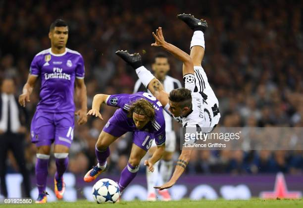 Luka Modric of Real Madrid and Paulo Dybala of Juvents battle for possession during the UEFA Champions League Final between Juventus and Real Madrid...