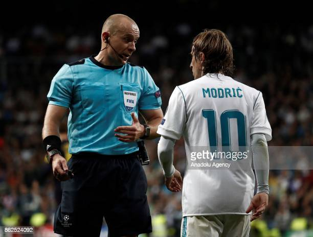 Luka Modric of Real Madrid argues with the referee Szymon Marciniak during the UEFA Champions League Group H match between Real Madrid and Tottenham...