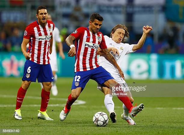 Luka Modric of Real Madrid battles for the ball with Augusto Fernandez of Atletico Madrid during the UEFA Champions League Final match between Real...