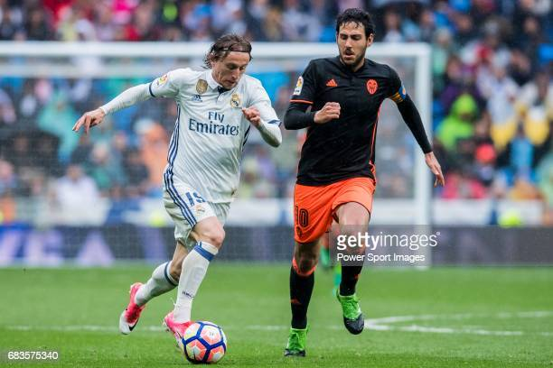 Luka Modric of Real Madrid battles for the ball with Daniel Parejo Munoz of Valencia CF during their La Liga match between Real Madrid and Valencia...