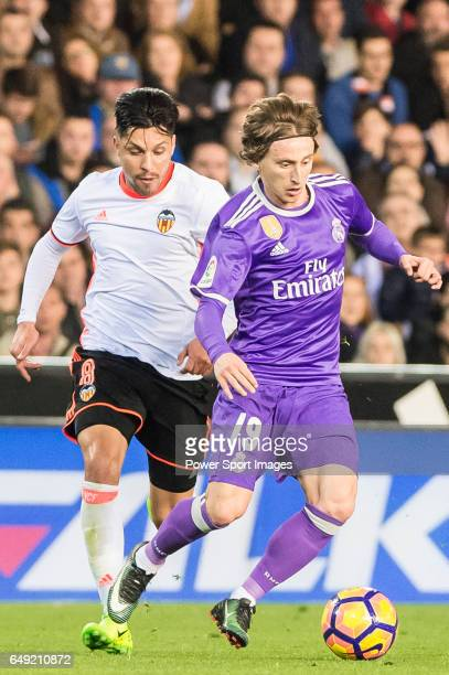 Luka Modric of Real Madrid battles for the ball with Enzo Nicolas Perez of Valencia CF during their La Liga match between Valencia CF and Real Madrid...