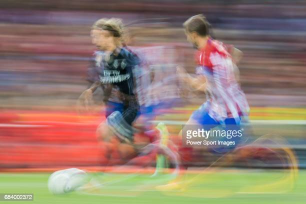 Luka Modric of Real Madrid battles for the ball with Gabriel Fernandez Arenas Gabi of Atletico de Madrid during their 201617 UEFA Champions League...