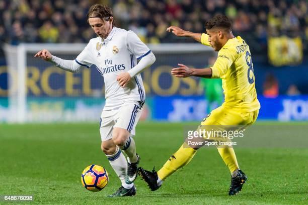 Luka Modric of Real Madrid battles for the ball with Jonathan Dos Santos of Villarreal CF during their La Liga match between Villarreal CF and Real...