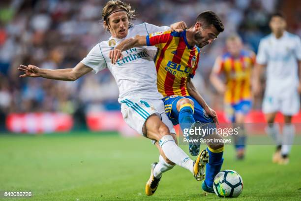Luka Modric of Real Madrid battles for the ball with Jose Luis Gaya Pena of Valencia CF during their La Liga 201718 match between Real Madrid and...