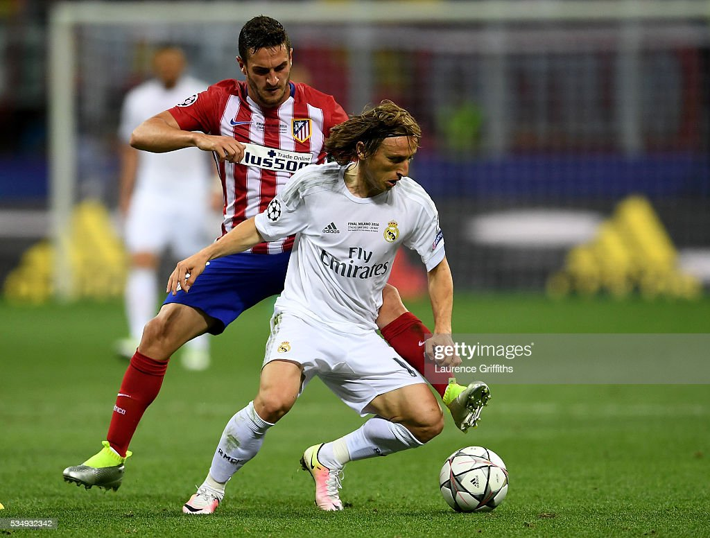 <a gi-track='captionPersonalityLinkClicked' href=/galleries/search?phrase=Luka+Modric&family=editorial&specificpeople=560350 ng-click='$event.stopPropagation()'>Luka Modric</a> of Real Madrid battles for the ball with <a gi-track='captionPersonalityLinkClicked' href=/galleries/search?phrase=Koke+-+Midfielder+born+1992&family=editorial&specificpeople=11132098 ng-click='$event.stopPropagation()'>Koke</a> of Atletico Madrid during the UEFA Champions League Final match between Real Madrid and Club Atletico de Madrid at Stadio Giuseppe Meazza on May 28, 2016 in Milan, Italy.