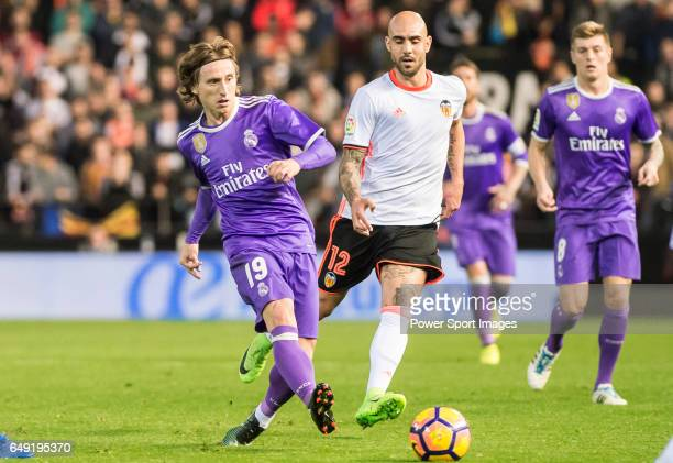 Luka Modric of Real Madrid battles for the ball with Simone Zaza of Valencia CF during their La Liga match between Valencia CF and Real Madrid at the...