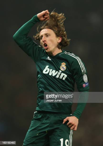 Luka Modric of Real Madrid celebrates scoring his team's first goal during the UEFA Champions League Round of 16 Second leg match between Manchester...