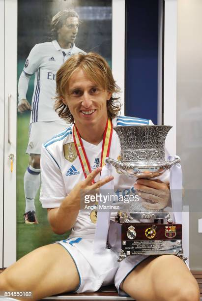 Luka Modric of Real Madrid celebrates with the trophy after the Supercopa de Espana Final second leg match between Real Madrid and FC Barcelona at...