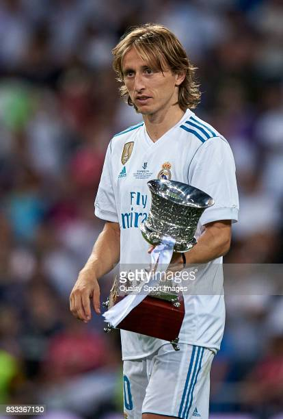 Luka Modric of Real Madrid celebrates with the trophy after winning the Supercopa de Espana Supercopa Final 2nd Leg match between Real Madrid and FC...