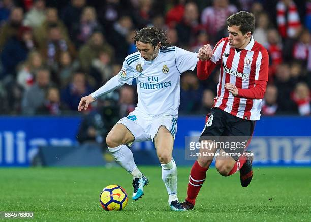 Luka Modric of Real Madrid CF being followed by Ander Iturraspe of Athletic Club during the La Liga match between Athletic Club and Real Madrid at...